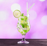 Glass of mojito cocktail on pink background Royalty Free Stock Photography