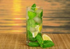 Glass with a mojito, lime and spearmint leaf Royalty Free Stock Photography