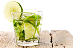 Glass mojito lime wood Royalty Free Stock Image