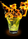 Glass with mojito splash and fire Stock Image