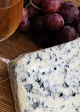 Glass, Moldy Cheese And Red Grapes Stock Images