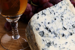 Glass,  moldy cheese and red grapes Royalty Free Stock Photo