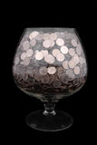 Glass with money. Wide glasswith money isolated on black Royalty Free Stock Photography