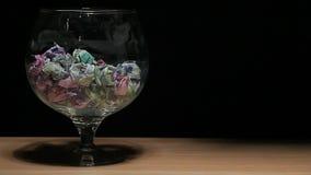 Glass money dark background nobody hd footage. Studio stock video footage