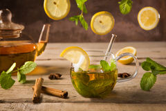 Glass of moroccan mint tea. With slices of lemon and mint leaves stock photo