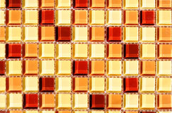Glass mosaic. Warm color glass mosaic tile with light reflections royalty free stock images