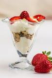 Glass of Muesli with strawberries and yogurt Stock Photography