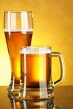 Glass and mug of beer Royalty Free Stock Photo