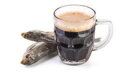 Glass mug with brown ale and dried fish Royalty Free Stock Photos