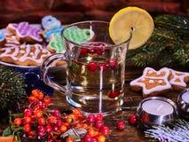 Glass mug and Christmas multicolored cookies on form stars. Stock Image