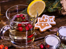 Glass mug and Christmas multicolored cookies on form stars. Royalty Free Stock Images