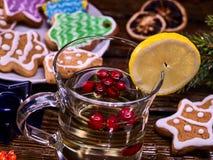 Glass mug and Christmas multicolored cookies on form stars. Stock Images