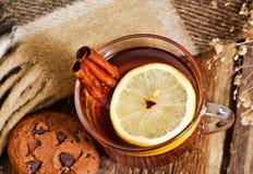 Glass mug of hot drink with a lemon and cinnamon Royalty Free Stock Photo