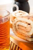 Glass mug with hot tea and chocolate cake for breakfast Stock Image