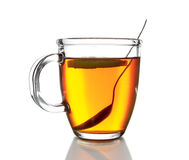 Glass mug with  tea, isolated on white background Royalty Free Stock Photo
