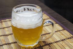 Glass mug of unfiltered weizen beer on table Stock Images