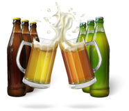 Glass mugs of beer and beer bottles Royalty Free Stock Photos