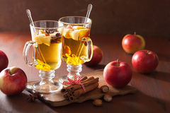 Glass of mulled apple cider with  orange and spices, winter drin Stock Photo