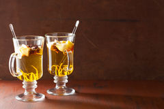 Glass of mulled apple cider with orange and spices, winter drink Royalty Free Stock Photo