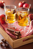 Glass of mulled cider with orange and spices, winter hot drink Stock Photo