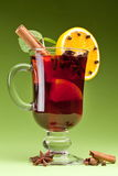 Glass of mulled green on a green Royalty Free Stock Images