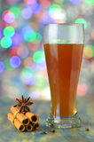 Glass of mulled spiced beer on bokeh background Stock Photo