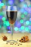 Glass of mulled spiced red wine on bokeh background Stock Images