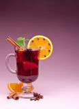 Glass of mulled wine. Glass of mulled wine on a pink background Stock Images