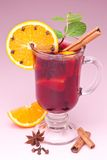 Glass of mulled wine. On a pink background royalty free stock image