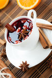 Glass of mulled wine with almonds Stock Image