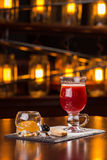 Glass of mulled wine. On the bar Royalty Free Stock Photos