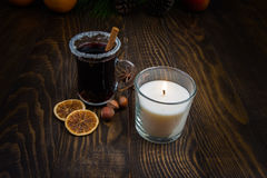 A glass of mulled wine in the candle light Stock Images