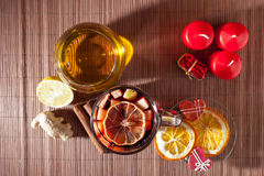 Glass of mulled wine and Christmas decorations, candles, gifts Royalty Free Stock Image