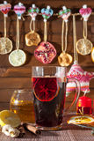Glass of mulled wine and Christmas decorations, candles, gifts Stock Images