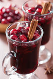 Glass of mulled wine with cranberry and spices, winter drink Stock Photo