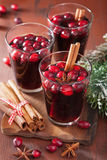 Glass of mulled wine with cranberry and spices, winter drink Stock Images