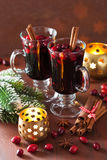 Glass of mulled wine with cranberry and spices, winter drink Royalty Free Stock Image