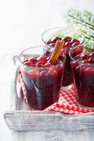 Glass of mulled wine with cranberry and spices, winter drink Stock Image