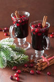 Glass of mulled wine with cranberry and spices, winter drink Royalty Free Stock Photos
