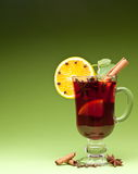 Glass of mulled wine on a green Stock Photos