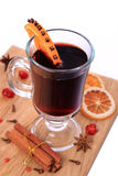 Glass of mulled wine and ingredients , selective focus Royalty Free Stock Photo