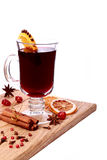 Glass of mulled wine and ingredients on a wooden table Royalty Free Stock Image