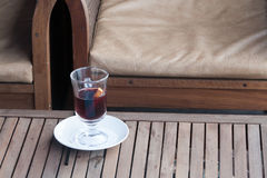 Glass with mulled wine on a little table in cafe Royalty Free Stock Photography