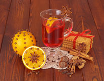 Glass of mulled wine on napkin and orange Stock Images