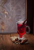 Glass of mulled wine  on old wooden table in winter frosty day Stock Photography