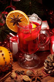Glass of mulled wine with orange Stock Image