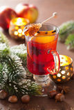 Glass of mulled wine with orange and spices, christmas decoratio Stock Images