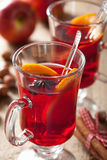 Glass of mulled wine with orange and spices, christmas decoratio Royalty Free Stock Photo