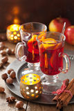Glass of mulled wine with orange and spices, christmas decoratio Royalty Free Stock Images