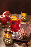 Glass of mulled wine with orange and spices, christmas decoratio Stock Photography